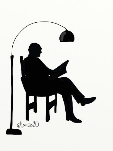 silueta de hombre leyendo junto a una lámpara